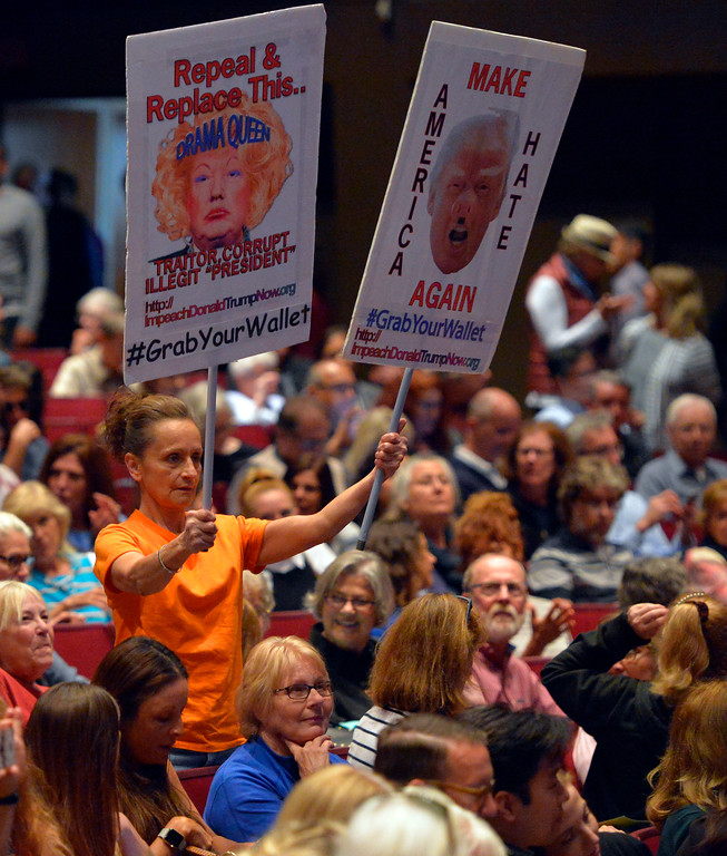 . An anti-Trump woman holds up her signs before Rep. Ted Lieu�s town hall meeting at the Redondo Beach Performing Arts Center in Redondo Beach, CA on Monday, April 24, 2017. The venue was filled primarily with his supporters, but a few vocal conservatives did their best to try to disrupt the gathering. (Photo by Scott Varley, Daily Breeze/SCNG)