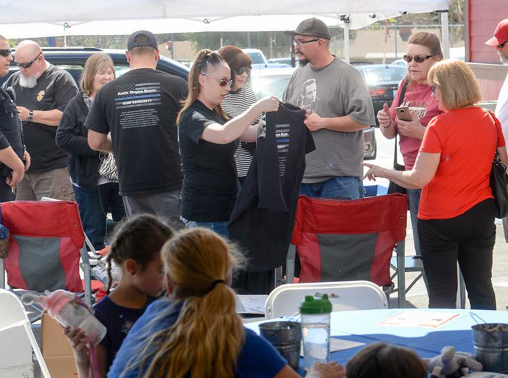 . Patrons buy t-shirts as the Owners of the Original Roadhouse Grill are donating 100 percent of the restaurant\'s profits to the family of slain Whittier Police Officer Keith Boyer on Thursday March 9, 2017. (Photo by Keith Durflinger/Whittier Daily News/SCNG)
