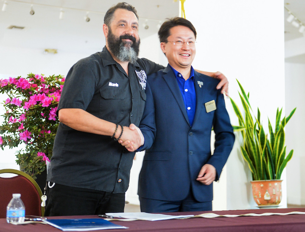. John Hsu, right, owner of the Nixon Plaza, and Chef Ricardo Diaz, left, shake hands after signing their lease as they unveil plans to transform the first floor of the historic building in Uptown Whittier into the Whittier Brewing Company on Wednesday April 5, 2017. (Photo by Keith Durflinger/Whittier Daily News/SCNG)