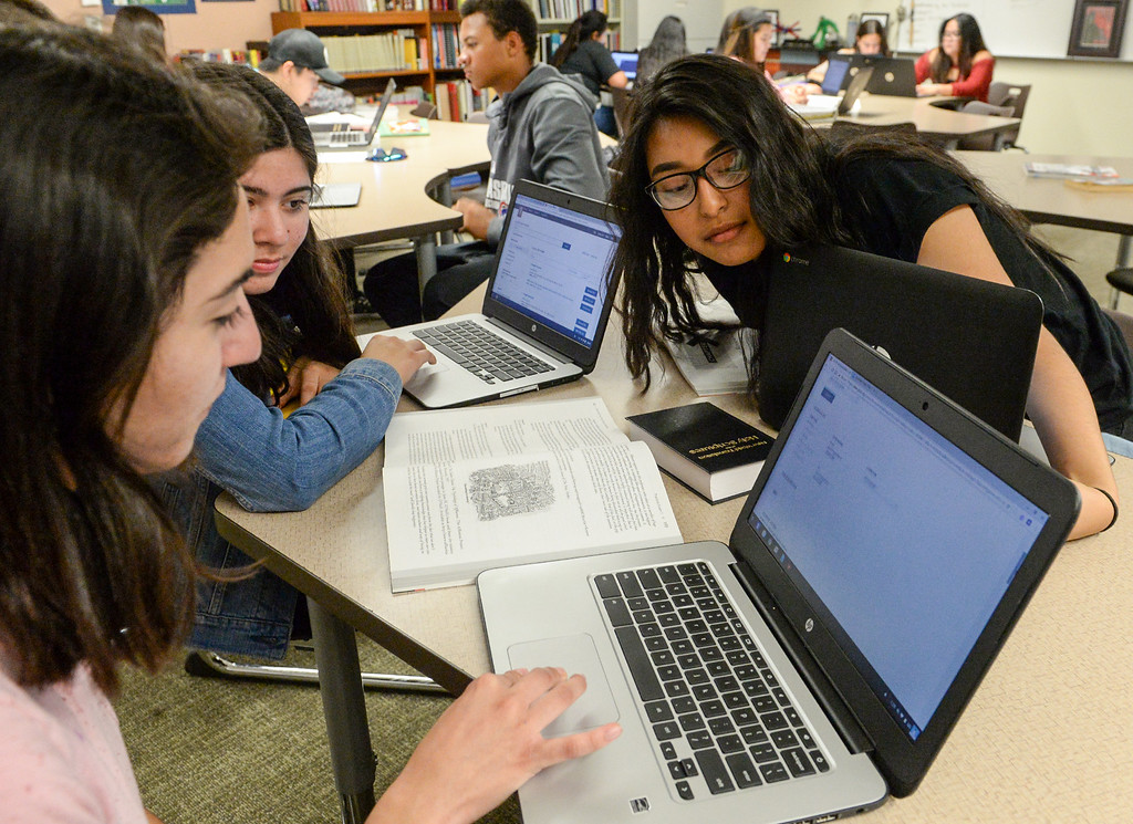 . Students Crystal Garcia, left, Styler Grijalva, left center and Jazmin Luciano use their Chromebooks as they work together in their AP English at Nogales High School in La Puente on Wednesday April 12, 2017. Rowland Unified had one of the highest increases in graduation rate in the area. (Photo by Keith Durflinger/Whittier Daily News/SCNG)