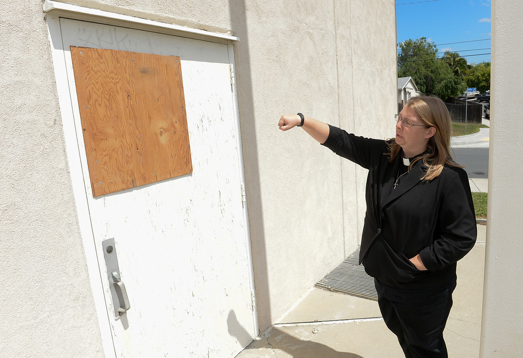 . Pastor Ashley Nicolls shows where burglars broke into their church and stole equipment and money at St. Andrew Lutheran Church in unincorporated South Whittier on Friday April 14, 2017. The thieve broke into the church Wednesday late afternoon stealing musical instruments, microphones, cash and gift cards that they use for donations to others. (Photo by Keith Durflinger/Whittier Daily News/SCNG)