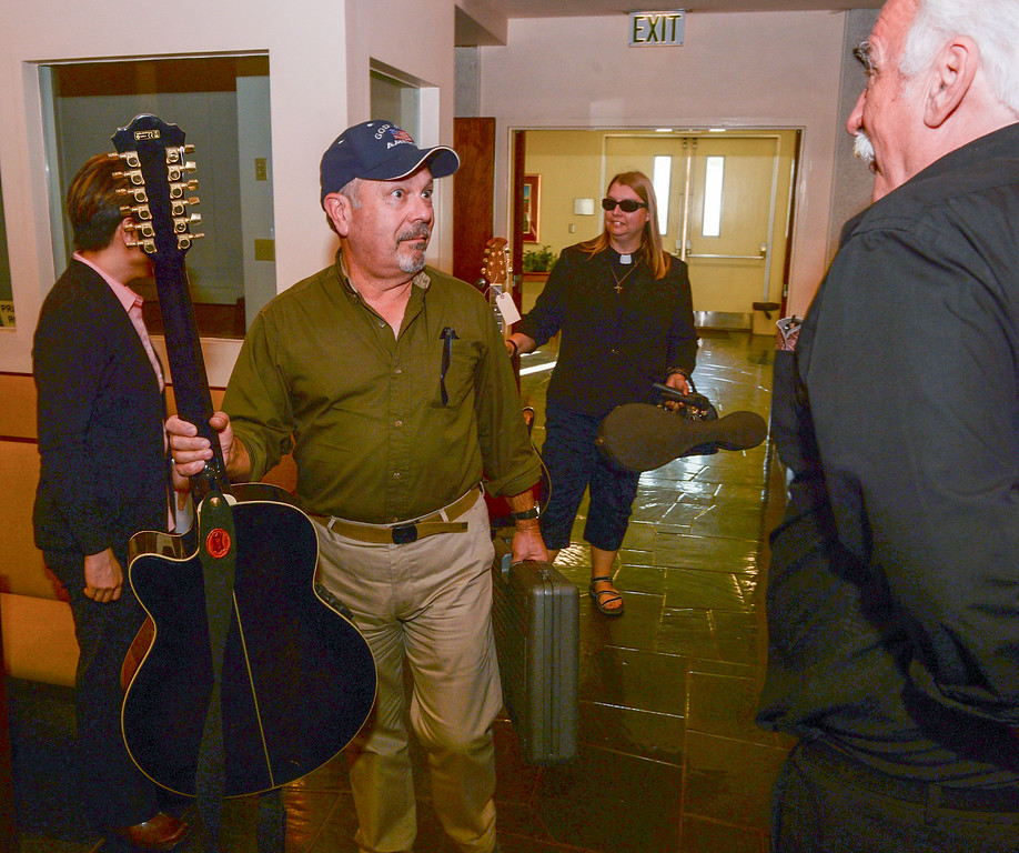 . Property manager Art Evueltas, center, and Pastor Ashley Nicolls talk with church members as they return with recovered stolen items at St. Anthony Lutheran Church in unincorporated South Whittier on Friday April 14, 2017. Thieves broke into the church Wednesday late afternoon and Los Angeles County Sheriff\'s detectives recovered the items. (Photo by Keith Durflinger/Whittier Daily News/SCNG)