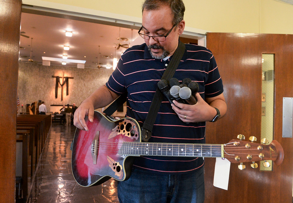 . Rejoice Band leader George Simmons happily wears his Ovation acoustic guitar and holds six microphones that were returned with recovered stolen items at St. Anthony Lutheran Church in unincorporated South Whittier on Friday April 14, 2017. Thieves broke into the church Wednesday late afternoon and Los Angeles County Sheriff\'s detectives recovered the items. (Photo by Keith Durflinger/Whittier Daily News/SCNG)
