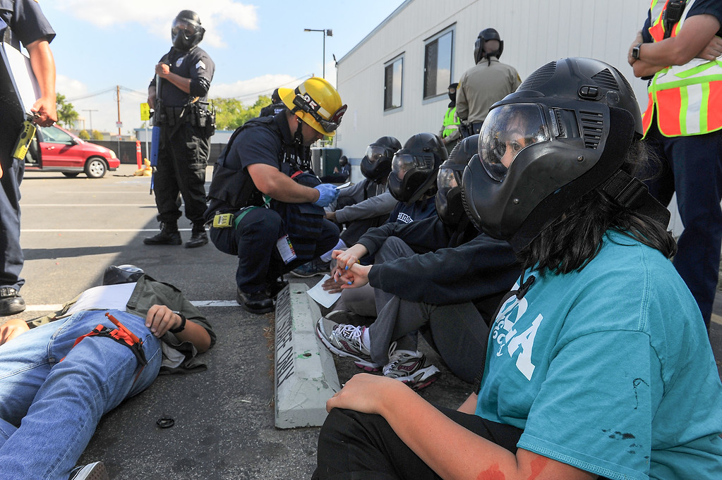. Biola student actors are assessed for their simulated injuries by Los Angeles County Firefighters during an active shooter response drill at Biola University in La Mirada on Wednesday April 19, 2017. The training incorporated simulated gunfire, simulated injuries and role players in the university. (Photo by Keith Durflinger/Whittier Daily News/SCNG)