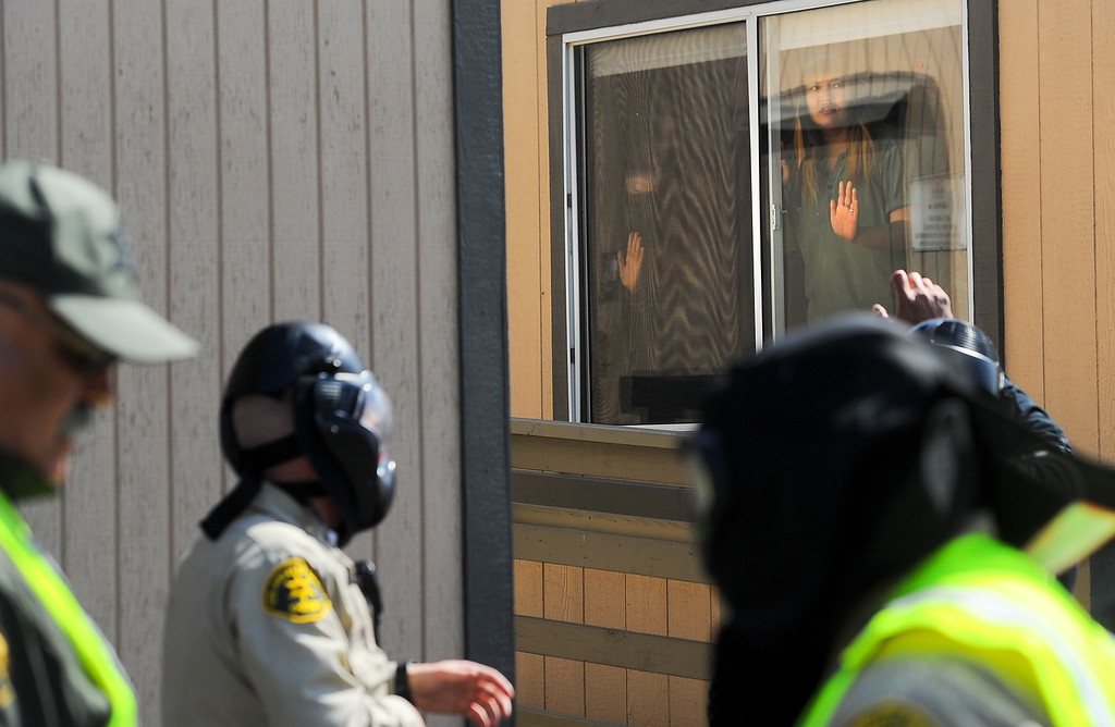 . Student actors yell at officers that they are trapped during an active shooter response drill at Biola University in La Mirada on Wednesday April 19, 2017. The training incorporated simulated gunfire, simulated injuries and role players in the university. (Photo by Keith Durflinger/Whittier Daily News/SCNG)