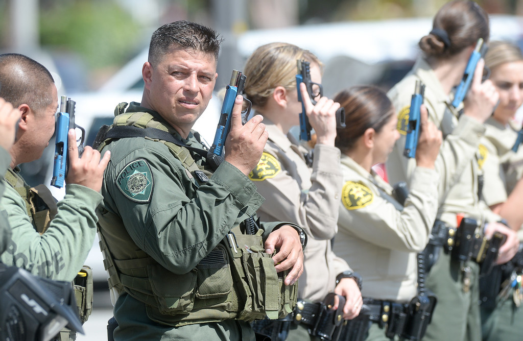 . Officers empty their simunition pistols as The Los Angeles County Sheriff�s Department�s Tactic�s and Survival Unit, Norwalk Sheriff�s Station, Biola University officers and officers from neighboring agencies and the Los Angeles County Fire Department conduct an active shooter response drill at Biola University in La Mirada on Wednesday April 19, 2017. The training incorporated simulated gunfire, simulated injuries and role players in the university. (Photo by Keith Durflinger/Whittier Daily News/SCNG)