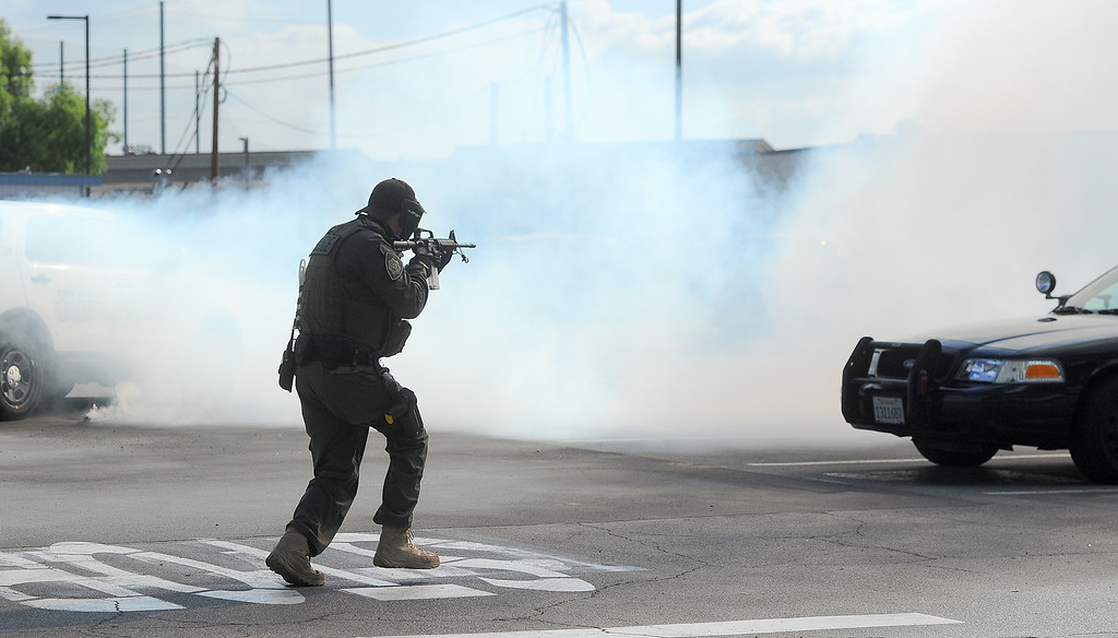 . An officer approches a simulated armed suspect as the Los Angeles County Sheriff�s Department�s Tactic�s and Survival Unit, Norwalk Sheriff�s Station, Biola University officers and officers from neighboring agencies and the Los Angeles County Fire Department conduct an active shooter response drill at Biola University in La Mirada on Wednesday April 19, 2017. The training incorporated simulated gunfire, simulated injuries and role players in the university. (Photo by Keith Durflinger/Whittier Daily News/SCNG)