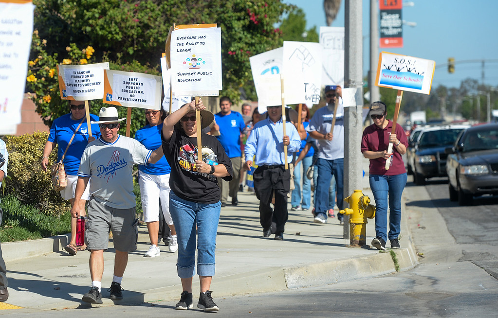 . El Rancho Unified workers participate in a march from El Rancho High School to the corner of Washington Boulevard and Rosemead Boulevard in support of unions, students and education in Pico Rivera on Monday May 1, 2017. (Photo by Keith Durflinger/Whittier Daily News/SCNG)
