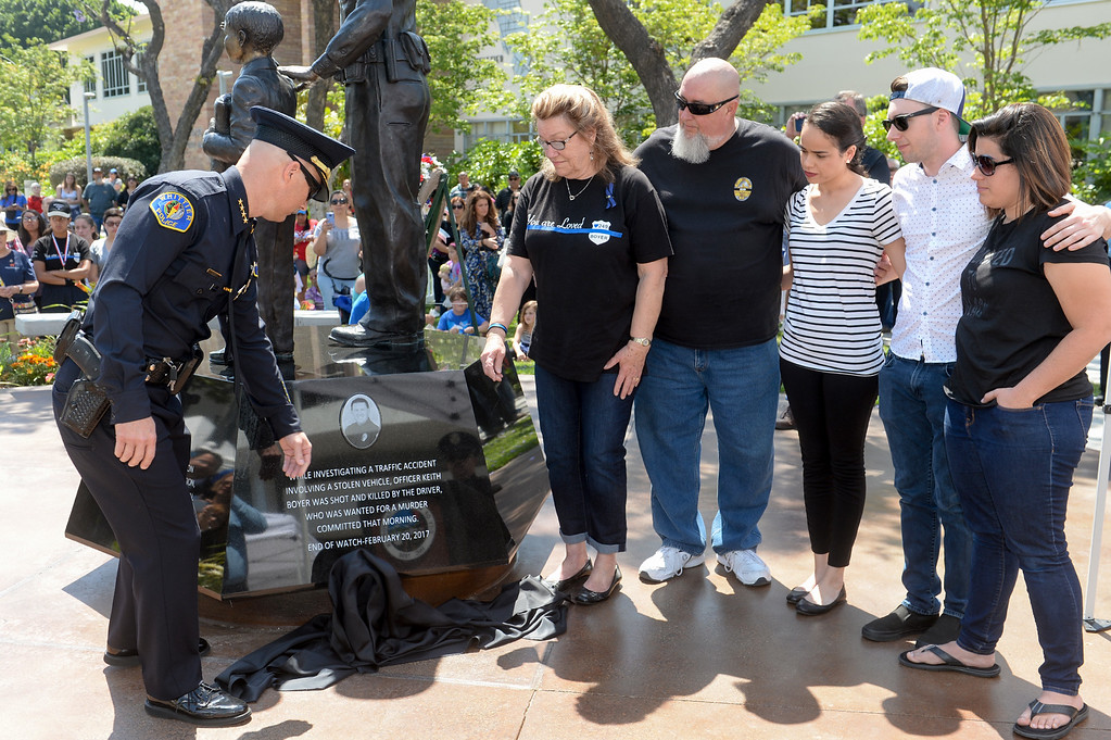 . Chief Jeff Piper,from left, Nancy Clark and Don Clark, Pamela Barreto, Joey Boyer and Ashley Sheleretis unveil the plaque honoring the late Officer Keith Boyer that is added to the Whittier Police Memorial during their Open House on Penn Street in Whittier on Saturday May 13, 2017. (Photo by Keith Durflinger/Whittier Daily News/SCNG)