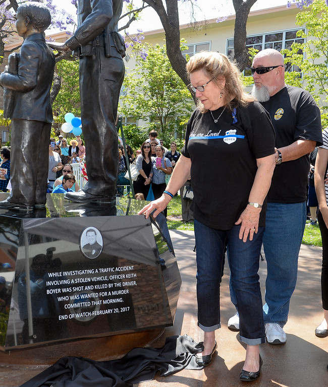 . Nancy Clark looks at the plaque bearing her son\'s name, Officer Keith Boyer, as she stands with her husband Don Clark, as it is added to the Whittier Police Memorial during their Open House on Penn Street in Whittier on Saturday May 13, 2017. (Photo by Keith Durflinger/Whittier Daily News/SCNG)