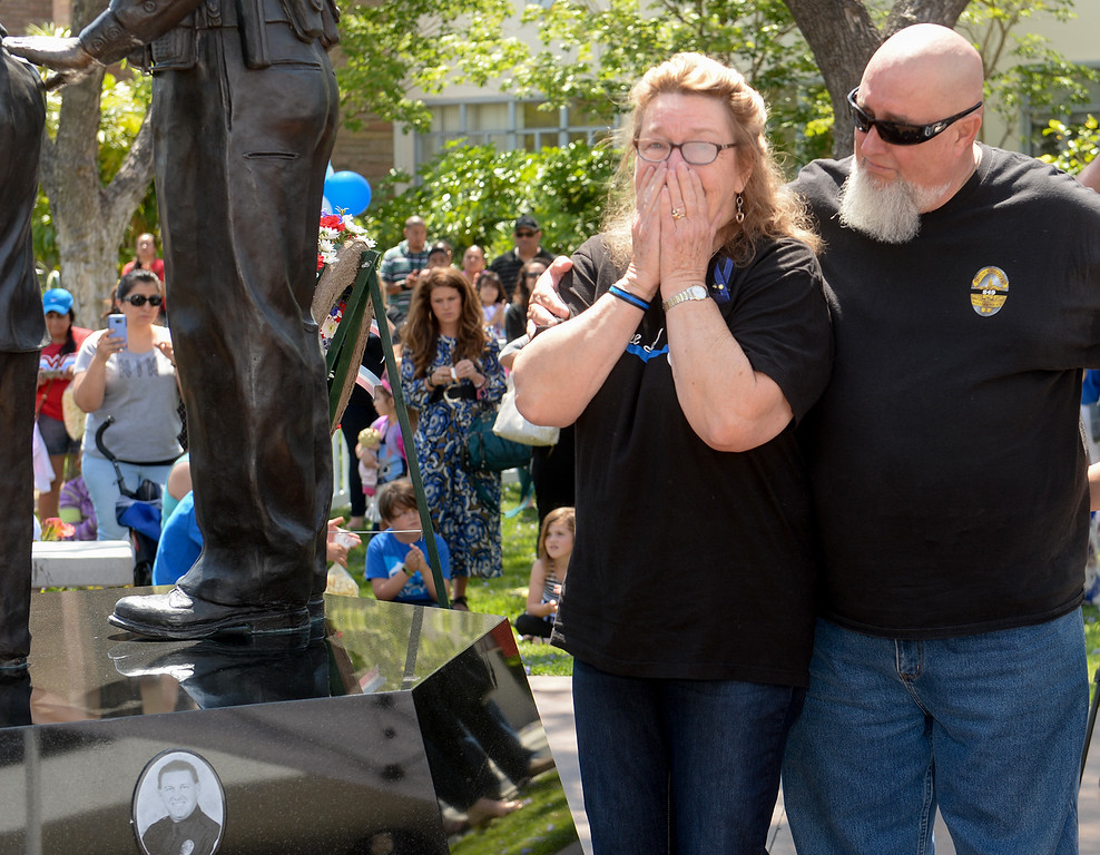. Nancy Clark reacts to the plaque bearing her son\'s name, Officer Keith Boyer, as she stands with her husband Don Clark, Pamela Barreto, and Joey Boyer that is added to the Whittier Police Memorial during their Open House on Penn Street in Whittier on Saturday May 13, 2017. (Photo by Keith Durflinger/Whittier Daily News/SCNG)