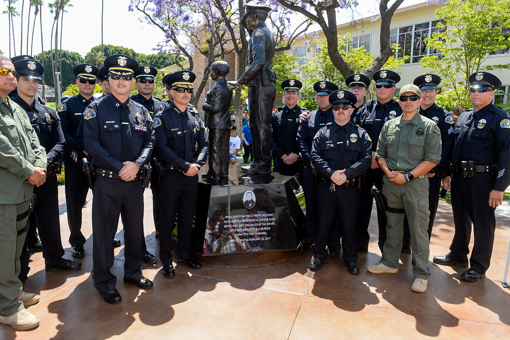 . Officers stand with the plaque late Officer Keith Boyer at the Whittier Police Memorial during the Whittier Police Department Open House on Penn Street in Whittier on Saturday May 13, 2017. (Photo by Keith Durflinger/Whittier Daily News/SCNG)
