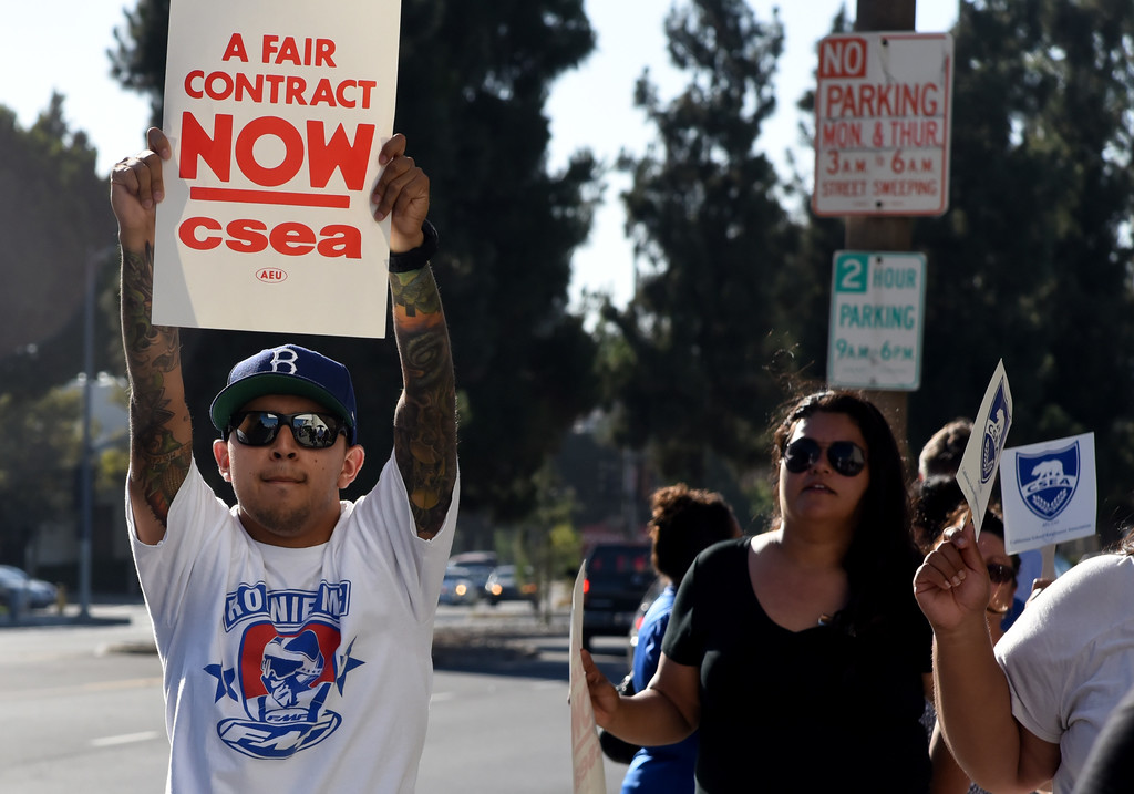 . Randy Hernandez, left,  protests due to contract negotiations outside of the district office at El Monte Union High School District Office in El Monte, Calif., on Wednesday, June 21, 2017. (Photos by Libby Cline, SGV Tribune/SCNG)