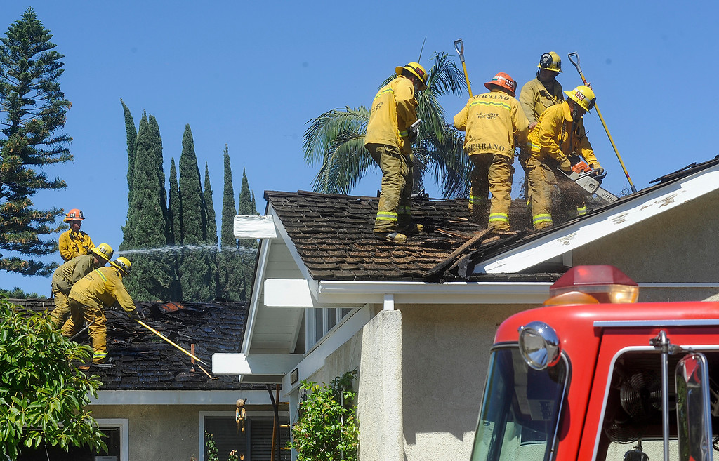 . Los Angeles County firefighters respond to a fire that started in a row of Cypress trees that spread to this home on the 20500-block of Vista Circle and then to a home on the 20500-block of Julliard Dr. in Walnut on Tuesday June 27, 2017.  (Photo by Keith Durflinger/San Gabriel Valley Tribune/SCNG)