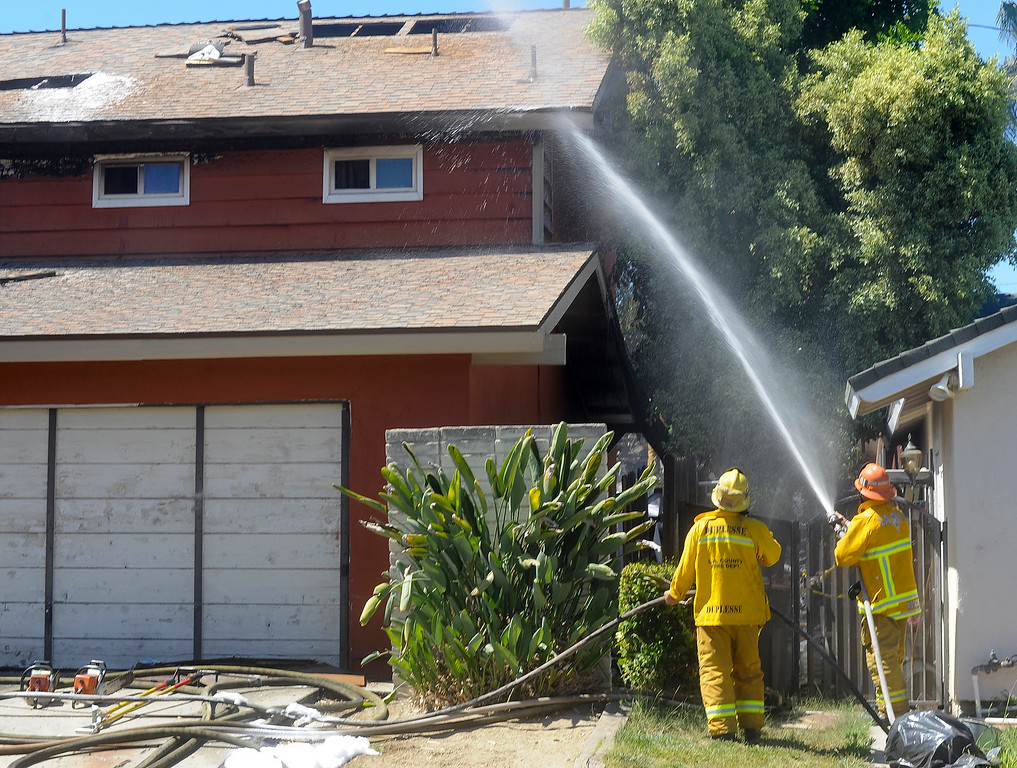 . Los Angeles County firefighters respond to a fire that started in a row of Cypress trees that spread to a home on the 20500-block of Vista Circle and then to a home on the 20500-block of Julliard Dr. in Walnut on Tuesday June 27, 2017.  (Photo by Keith Durflinger/San Gabriel Valley Tribune/SCNG)