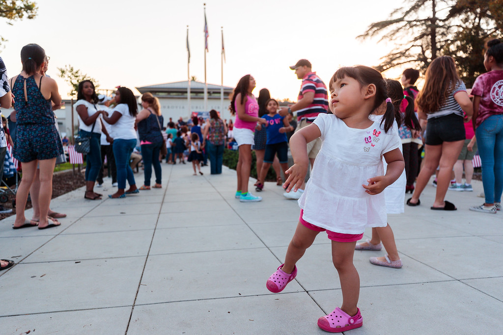 . A child dances during the City of Monrovia 4th of July Concert and Fireworks Show at Liberty Park in Monrovia, Calif., on Tuesday July 4, 2017. (Photo by contributor Raul Romero Jr - raulromero@gmail.com)