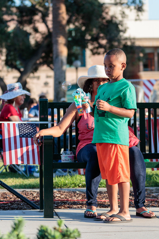 . Arden Bartlett watches as her son blows bubbles during the City of Monrovia 4th of July Concert and Fireworks Show at Liberty Park in Monrovia, Calif., on Tuesday July 4, 2017. (Photo by contributor Raul Romero Jr - raulromero@gmail.com)