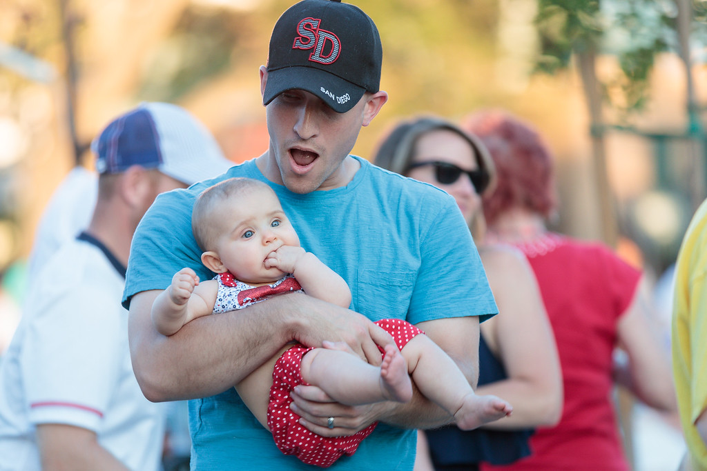 . James O\'Brian dances with his baby during the City of Monrovia 4th of July Concert and Fireworks Show at Liberty Park in Monrovia, Calif., on Tuesday July 4, 2017. (Photo by contributor Raul Romero Jr - raulromero@gmail.com)