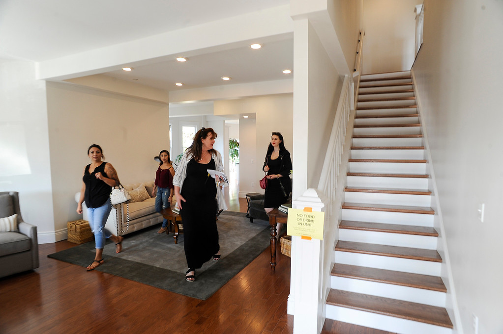 . Guests and city officials tour and rededicate the local historic landmark, Guilford Hall, at Comstock Avenue and Penn Street in Whittier on Thursday July 6, 2017. Guilford Hall, built in 1903, was moved from its second location at Whittier College to its current location at the Guilford Court complex. (Photo by Keith Durflinger, Whittier Daily News/SCNG)
