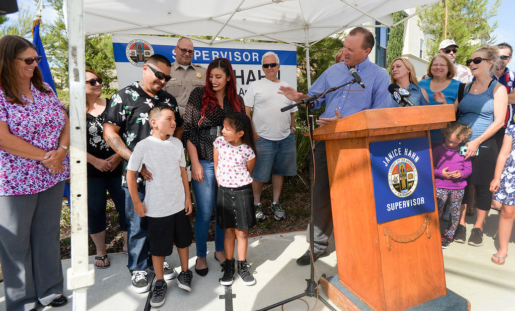 . Lowell Joint School District Superintendent, Jim Coombs, talks to student Cruz Valdez, 8, as Los Angeles County Supervisor Janice Hahn dedicates the new traffic signal at First Avenue and Candlelight Drive in unincorporated East Whittier July 27, 2017. The intersection which has been the site of several serious traffic incidents within the past five years. (Photo by Keith Durflinger, Whittier Daily News/SCNG)