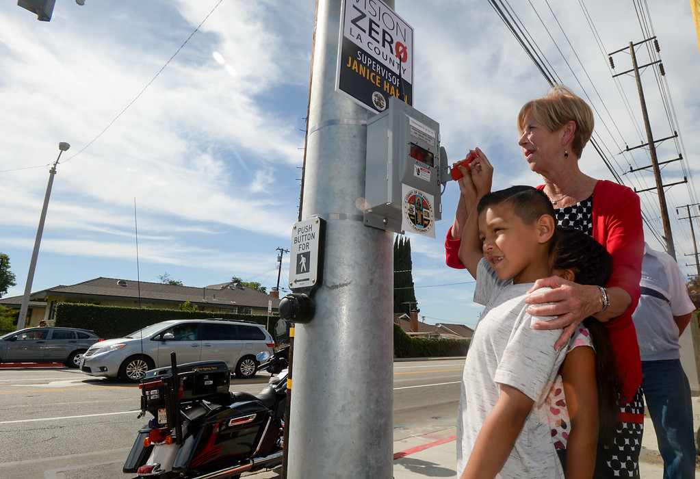 . Los Angeles County Supervisor Janice Hahn with Cruz Valdez, 8, and his sister Rose, 7, turn on the new traffic signal at First Avenue and Candlelight Drive in unincorporated East Whittier July 27, 2017. The intersection which has been the site of several serious traffic incidents within the past five years. (Photo by Keith Durflinger, Whittier Daily News/SCNG)