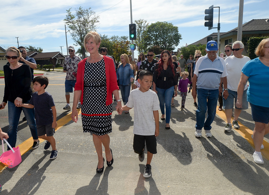 . Los Angeles County Supervisor Janice Hahn and Cruz Valdez, 8, with neighbors cross First Avenue with the new traffic signal at1 Candlelight Drive in unincorporated East Whittier July 27, 2017. The intersection which has been the site of several serious traffic incidents within the past five years. (Photo by Keith Durflinger, Whittier Daily News/SCNG)