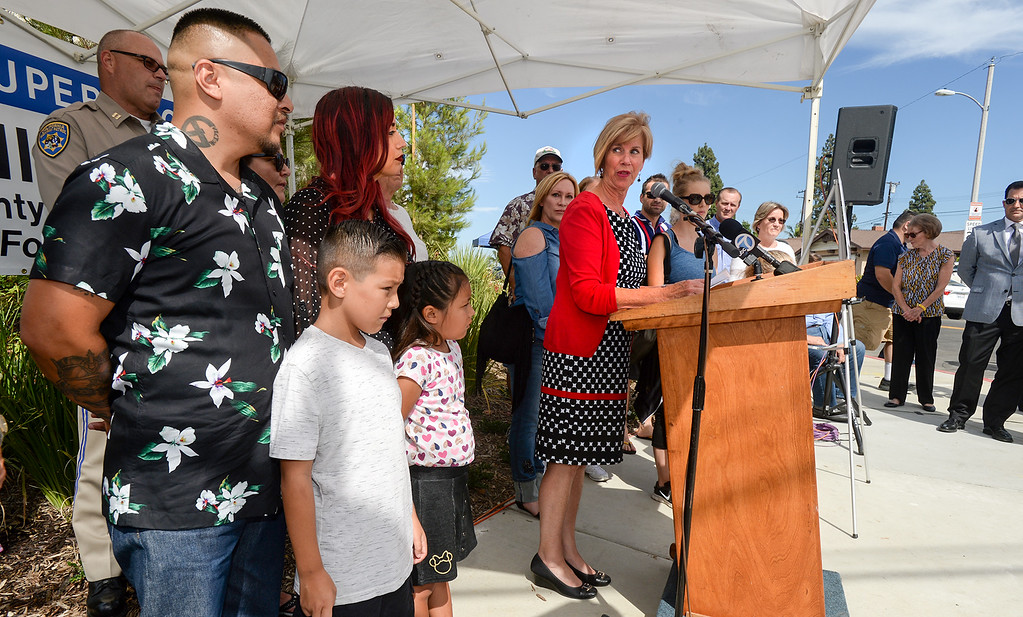 . Los Angeles County Supervisor Janice Hahn dedicates the new traffic signal with Carlos and Amber Valdez, and their children, Cruz, 8, and Rose, 7, at First Avenue and Candlelight Drive in unincorporated East Whittier July 27, 2017. The intersection which has been the site of several serious traffic incidents within the past five years. (Photo by Keith Durflinger, Whittier Daily News/SCNG)