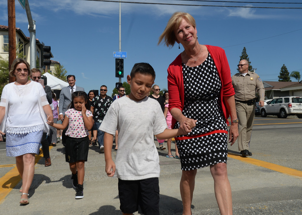 . Los Angeles County Supervisor Janice Hahn and Cruz Valdez, 8, cross First Avenue with the new traffic signal at1 Candlelight Drive in unincorporated East Whittier July 27, 2017. The intersection which has been the site of several serious traffic incidents within the past five years. (Photo by Keith Durflinger, Whittier Daily News/SCNG)