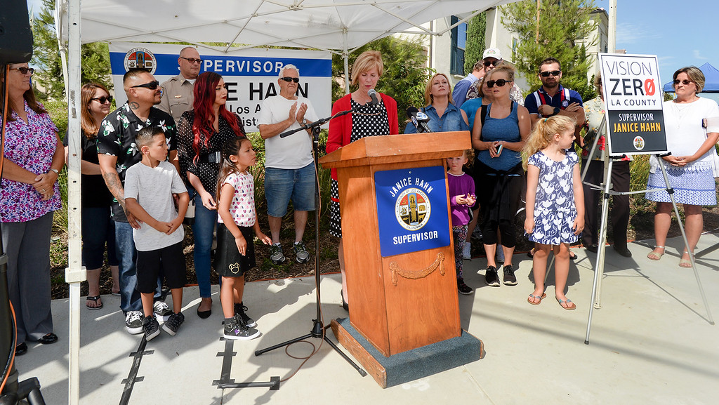 . Los Angeles County Supervisor Janice Hahn with Cruz Valdez, 8, dedicates the new traffic signal at First Avenue and Candlelight Drive in unincorporated East Whittier July 27, 2017. The intersection which has been the site of several serious traffic incidents within the past five years. (Photo by Keith Durflinger, Whittier Daily News/SCNG)
