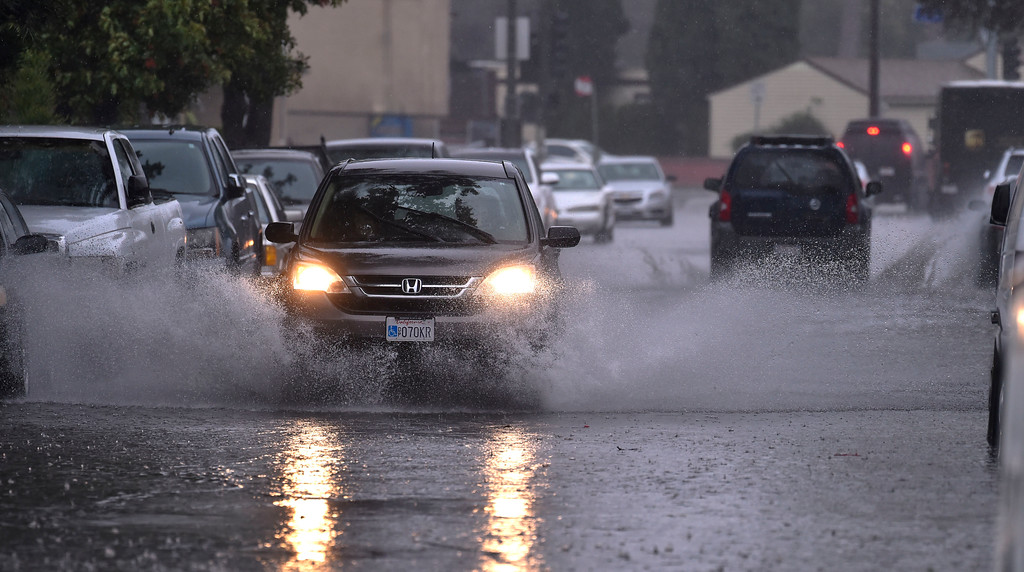 . Drivers make their way along a flooded portion of Delta Avenue in Long Beach, CA on Friday, February 17, 2017. (Photo by Scott Varley, Press-Telegram/SCNG)