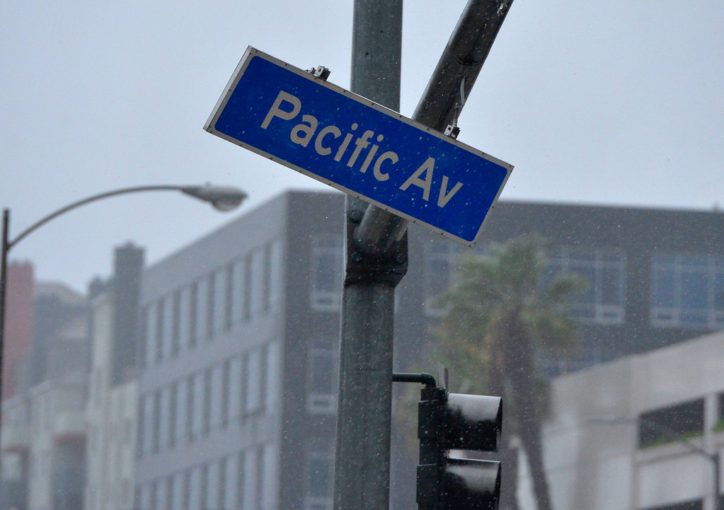 . A dangling street sign blows violently in the strong winds over Ocean Blvd in Long Beach, CA on Friday, February 17, 2017. (Photo by Scott Varley, Press-Telegram/SCNG)