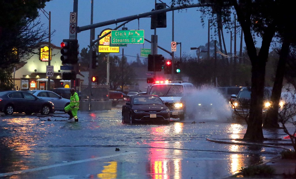 . February 17, 2017  Photo by Tracey Roman/for the Press-Telegram Cars stalled at the intersection of Stearns and Clark in East Long Beach after a big cell moved through the area Friday and flooded the streets.