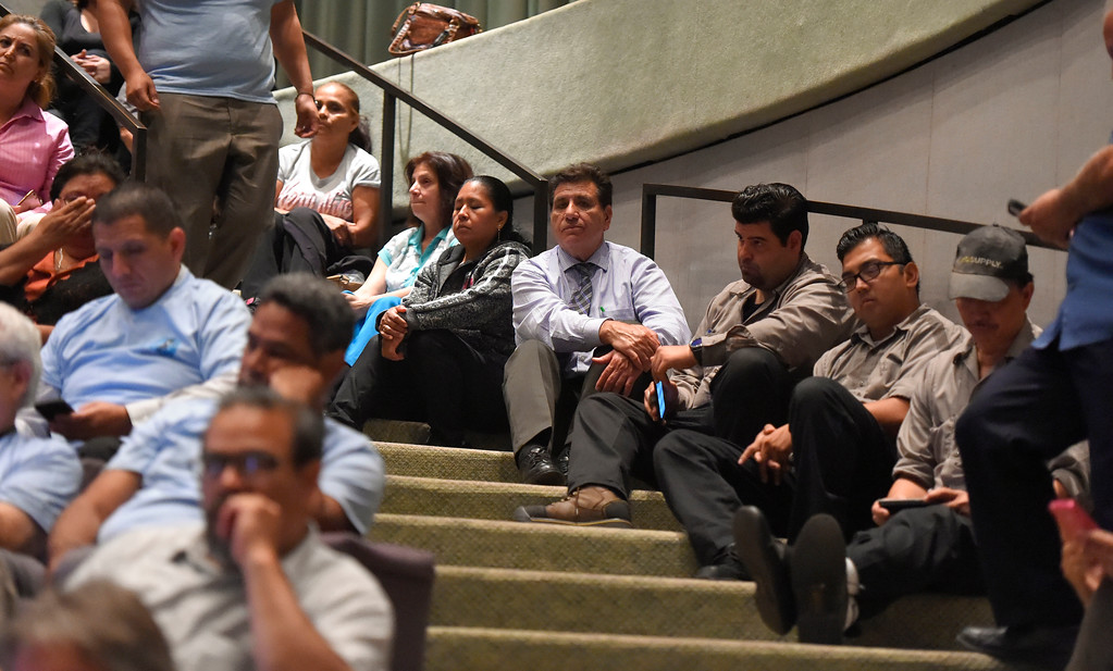 . An packed crowd in council chambers had people sitting in the aisle stairs during a city council meeting in Long Beach on Tuesday, September 19, 2017. Among the items on the agenda were discussions on the Southeast Area Specific Plan (SEASP), an ordinance regarding hotels and their workers and Long Beach as a sanctuary city. (Photo by Scott Varley, Press-Telegram/SCNG)