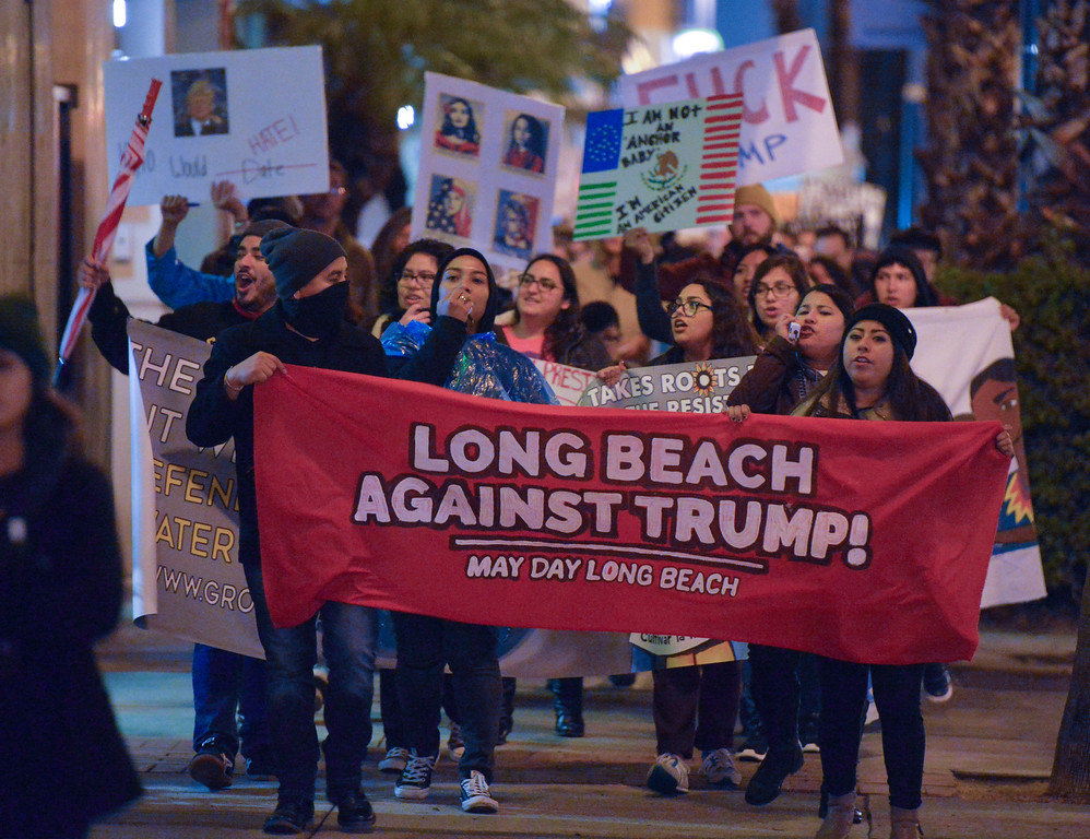 . Nearly 200 people gather and march in protest of the inauguration of President Donald Trump in Long Beach, CA on Friday, January 20, 2017. The May Day Long Beach Coalition organized the rally and march to protest Trump�s inauguration. After a rally at Harvey Milk Park, the group marched in a loop around downtown to nearby Promenade Square. The event was peaceful. (Photo by Scott Varley, Press-Telegram/SCNG)