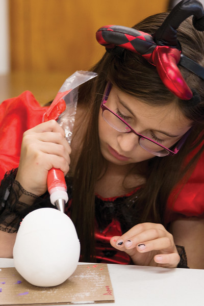 Matthew Gaston | The Sheridan Press<br>Aspen Webber patiently decorates a sugar skull during Spanish class on Hallloween at Holy Name Catholic School Wednesday, Oct. 31, 2018.