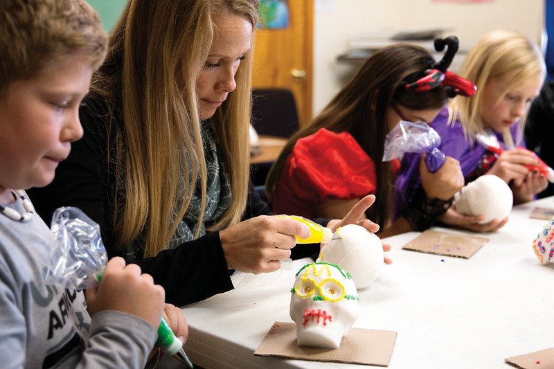 Matthew Gaston | The Sheridan Press<br>Monty Morris, left, decorates sugar skulls with his mother, Mandy Morris during a Spanish lesson Wednesday, Oct, 31, 2018 at Holy Name Catholic School.