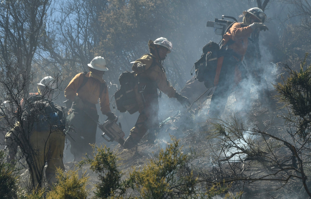 . May 19, 2017. Malibu CA.  LA county fire battle a 2nd alarm brush fire in Malibu Friday. A two-alarm fire Friday burned 10+ acres of brush on a Malibu hillside, prompting the closure of Kanan Rd. Firefighters were sent to the area of Mulholland Highway and Kanan Rd.  about 12:45 p.m., and battled the flames with ground crews and three water-dropping helicopters and about 200 firefighters responded to the fire.  Photo by Gene Blevins/LA DailyNews/SCNG