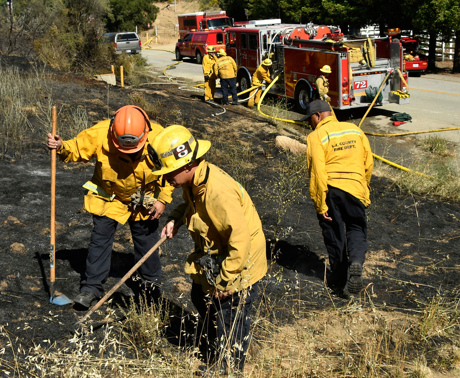 . May 19, 2017. Malibu CA.  LA county fire investigators look over the point of origin of a 2nd alarm brush fire in Malibu Friday. A two-alarm fire Friday burned 10+ acres of brush on a Malibu hillside, prompting the closure of Kanan Rd. Firefighters were sent to the area of Mulholland Highway and Kanan Rd.  about 12:45 p.m., and battled the flames with ground crews and three water-dropping helicopters and about 200 firefighters responded to the fire.  Photo by Gene Blevins/LA DailyNews/SCNG