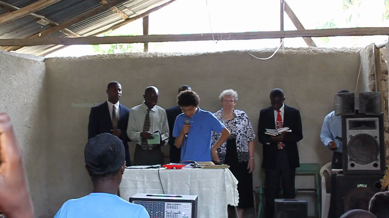 DeShawn Bello Wallace was the youngest missionary on the 2011 trip.  He read a scripture during Sabbath worship.