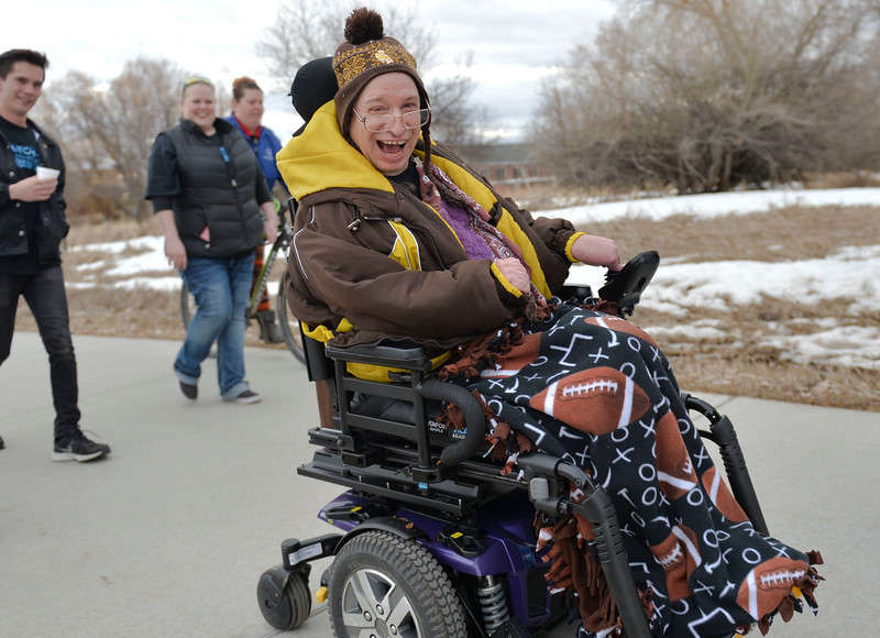 Justin Sheely | The Sheridan Press<br /> Paul Seagraves rolls along the path during the annual Disabilities Awareness March at South Park Friday March 23, 2018. March was established as national Developmental Disabilities Awareness Month by President Ronald Reagan in 1987.
