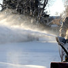 0107COLD.jpg Bob Junior (cq) braves the cold weather to use his snow blower to clear the sidewalks of snow in his neighborhood in Louisville, Colorado January 7, 2010.  CAMERA/Mark Leffingwell