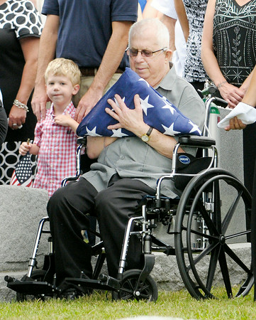 Don Knight   The Herald Bulletin<br /> Ray Martin holds the flag that draped his brother Howard Martin's casket during his burial service at the Elwood Cemetery on Saturday.