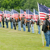 Don Knight | The Herald Bulletin<br /> Patriot Guard members hold flags during Howard Martin's burial service at the Elwood Cemetery on Saturday.
