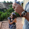 PIGEONS02.JPG PIGEONS<br /> Brianna Williams, 6, cuddles one of her father's racing pigeons while he holds another at their Gunbarrel home. <br /> Photo by Marty Caivano/Camera/Aug. 17, 2010