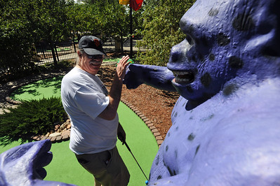 WILD02.JPG WILD Charlie Douglass of Boulder tries to figure out how to avoid the embracing arms of a giant purple gorilla while playing miniature golf at Gateway Fun Park on Tuesday afternoon. Photo by Marty Caivano/Camera/Aug. 31, 2010