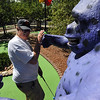 WILD02.JPG WILD<br /> Charlie Douglass of Boulder tries to figure out how to avoid the embracing arms of a giant purple gorilla while playing miniature golf at Gateway Fun Park on Tuesday afternoon.<br /> Photo by Marty Caivano/Camera/Aug. 31, 2010