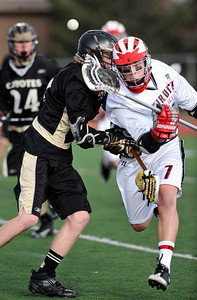LACROSSE11.JPG LACROSSE Fairview's John Weil loses the ball while being checked by Kyle Doner of Monarch. Photo by Marty Caivano/Camera/April 1, 2010