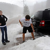 "HAIL.JPG HAIL<br /> Renee Anderson, left, and Greg Flood, visiting from Tulsa, Okla., dig a path for their car through piles of hail that fell on the town of Eldora, just outside Nederland, on Wednesday afternoon. A reported eight inches of hail fell, causing cars to get stuck and requiring a grader to clear the road. <br /> For a video of the storm aftermath, see  <a href=""http://www.dailycamera.com"">http://www.dailycamera.com</a>.<br /> Photo by Marty Caivano/Camera/July 28, 2010"