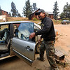 FOURMILE01.JPG FOURMILE<br /> Tom Colby, who has lived in Gold Hill for 21 years, races to evacuate himself and his dog during the Fourmile Canyon fire on Monday. He was forced to leave his cat, which refused to be caught.<br /> Photo by Marty Caivano/Camera/Sept.6, 2010