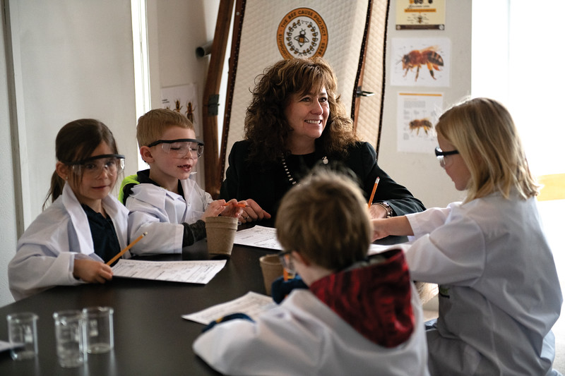 Matthew Gaston | The Sheridan Press<br>Holy Name Catholic School principal Mary Legler helps kindergartners during their science class Wednesday, Feb. 27, 2019.